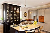 Vintage pendant lamp above island counter in traditional kitchen
