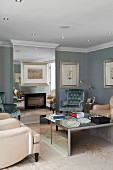 Surprising effects in mirrored chimney breast and coffee table in traditional, elegant living room