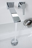 Water running from a square wall tap