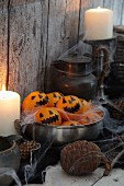 Tangerines decorated with spooky Jack-o'-lantern faces for Halloween