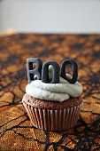 Halloween cupcakes topped with buttercream icing and decorative letters