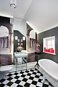 Bathroom visually enlarged by wallpaper murals of archways leading to city squares and large mirror; lettering reading 'Bath' as bright red accent