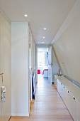 Hallway with ample storage in knee-wall-height sideboard and integrated cupboards