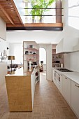 White designer kitchen with brass counter and gallery
