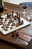 Game of chess on rustic wooden table