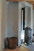 Wicker basket and antique stove in niche