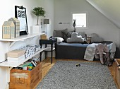 Vintage-style attic room with comfortable bed, pale grey leather rug, crate of books and soft toys