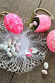 Easter eggs and sugar eggs on lace doily