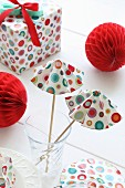 Hand-crafted paper cocktail umbrellas, honeycomb paper balls and wrapped present