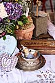 Vintage arrangement of antique teacup, hydrangea, lavender bags & boxes