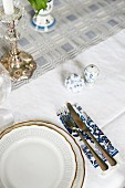 Traditional place setting with cruet and candlestick