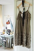 Cocktail dress hanging on door and view of dressing table
