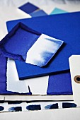 Indigo-dyed papers