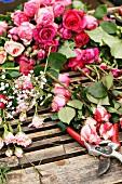 Cut roses and secateurs