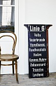 Thonet bentwood chair next to vintage tram sign listing Danish tram stops