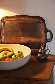 White fruit bowl and tray on top of cabinet