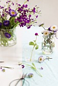 Arrangements of spring flowers on table
