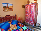 A room furnished with colourful accessories in Riad le Mazagao in El Jadida, Morocco