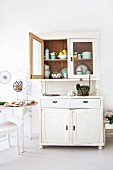 Country-house-style kitchen with crockery in white dresser