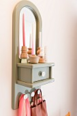 Grey-painted wall bracket with mirror