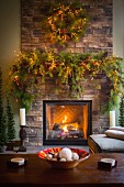 Christmas wreath and garland over fireplace in living room