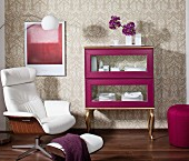 Display case hand-made from separate components painted purple and gold in eclectic interior