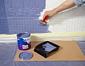 Painting Lincrusta (structured linoleum wallpaper) with blue paint
