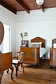 Antique, Biedermeier-style twin beds in simple bedroom
