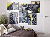 Poster with zebra motifs arranged as African collage in multiple, small picture frames