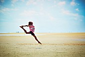 A girl jumping on the beach