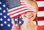 A girl with pigtails between waving flags