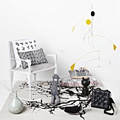 Mobile by Alexander Calder above collection of various figurines, cushions and delicate rocking chair