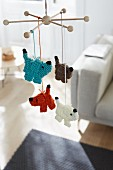 Knitted dogs hanging on a mobile