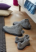 Knitted grey slippers with black leather soles