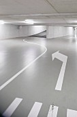 Driving lanes with road markings in underground car park
