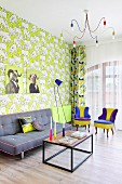 Colourful living area with patterned wallpaper in retro interior