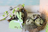 Easter nests with speckled eggs decorated with felt bunny