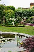 Water lilies in round pond in summery garden