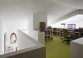 Workspace with half-height shelving and green floor on gallery