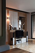 Hi-fi system and flatscreen TV in and on low sideboard in elegant interior