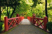 Secluded wooden bridge in Pukekura Park, New Plymouth; New Zealand