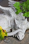Stone dragon on garden wall