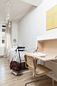 Modern writing desk, cantilever chair, single bed and parquet floor in minimalist bedroom