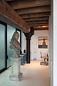 Baroque-style bust on plinth in loft apartment