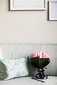 Bouquet of roses on sofa next to silver scatter cushion