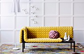 Yellow structured cushions and cushion made from interwoven cord on designer récamier