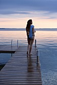 Woman wearing bikini on wooden jetty