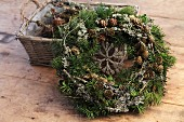 Hand-crafted Christmas wreath of conifer branches and larch cones