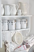 White kitchen utensils on shabby-chic shelves