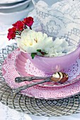 Pink place setting decorated with flowers & doilies